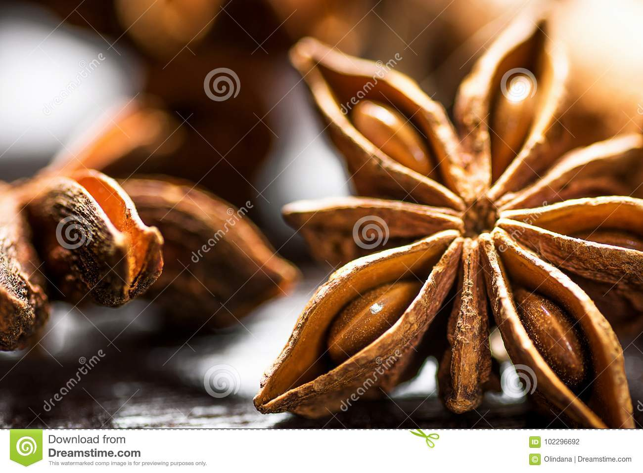 Christmas Baking Ingredients Cinnamon Sticks Anise Star Cloves Cardamom Scattered on Wood Background Macro of Details.