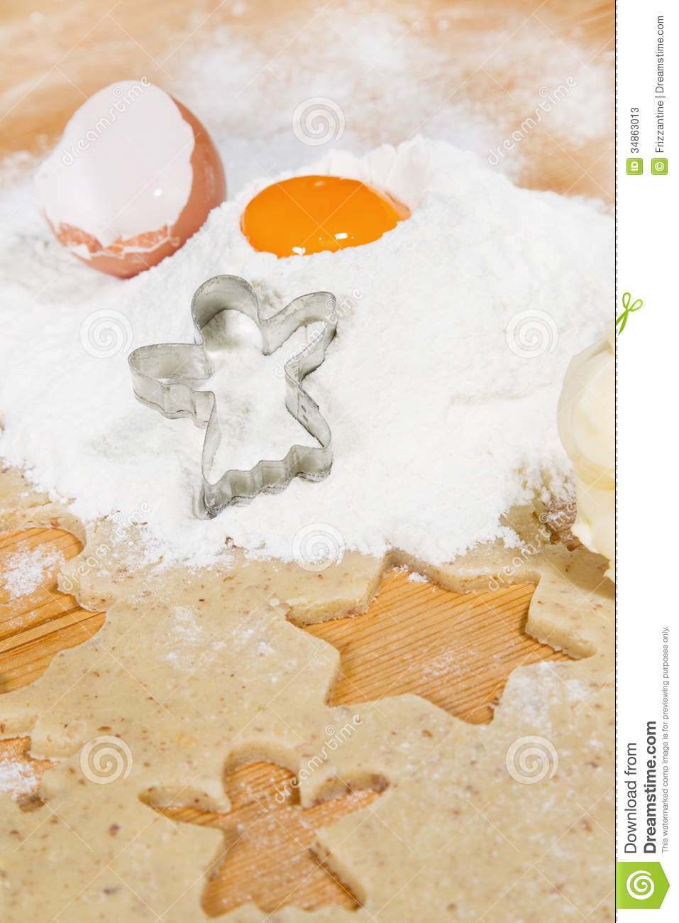 Christmas baking: snow angel cutter in flour with egg yolk