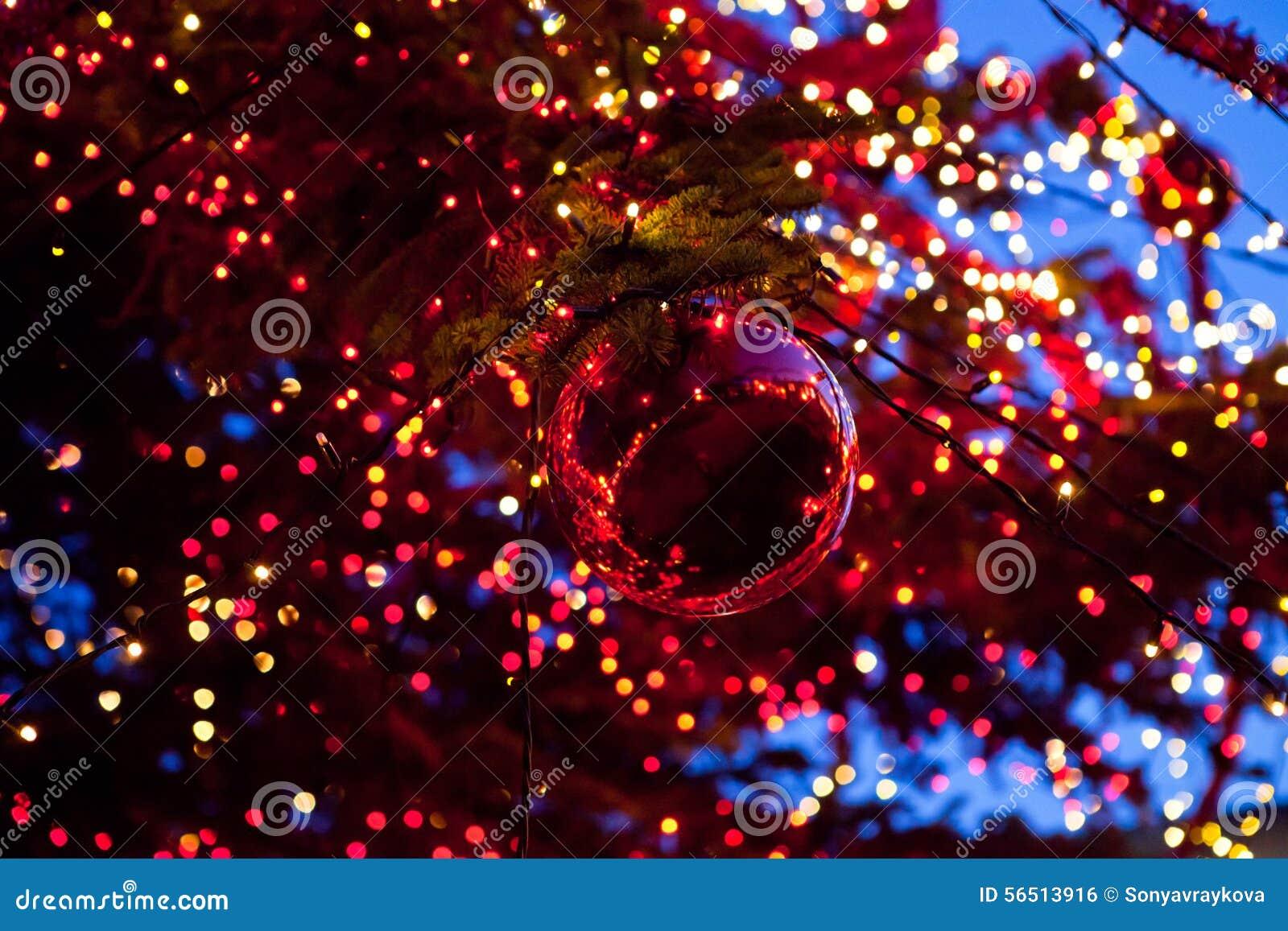 Christmas ball with ornament lights on a tree