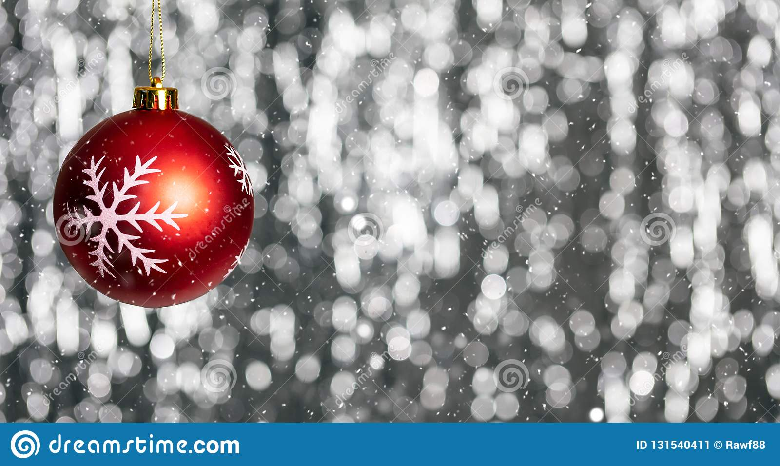 Christmas ball and snow in the night, abstract bokeh lights background, banner,