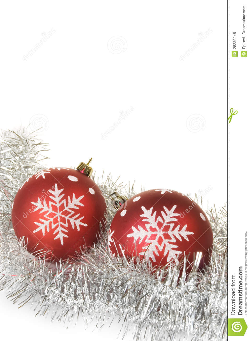 Christmas balls with snowflakes on tinsel royalty free