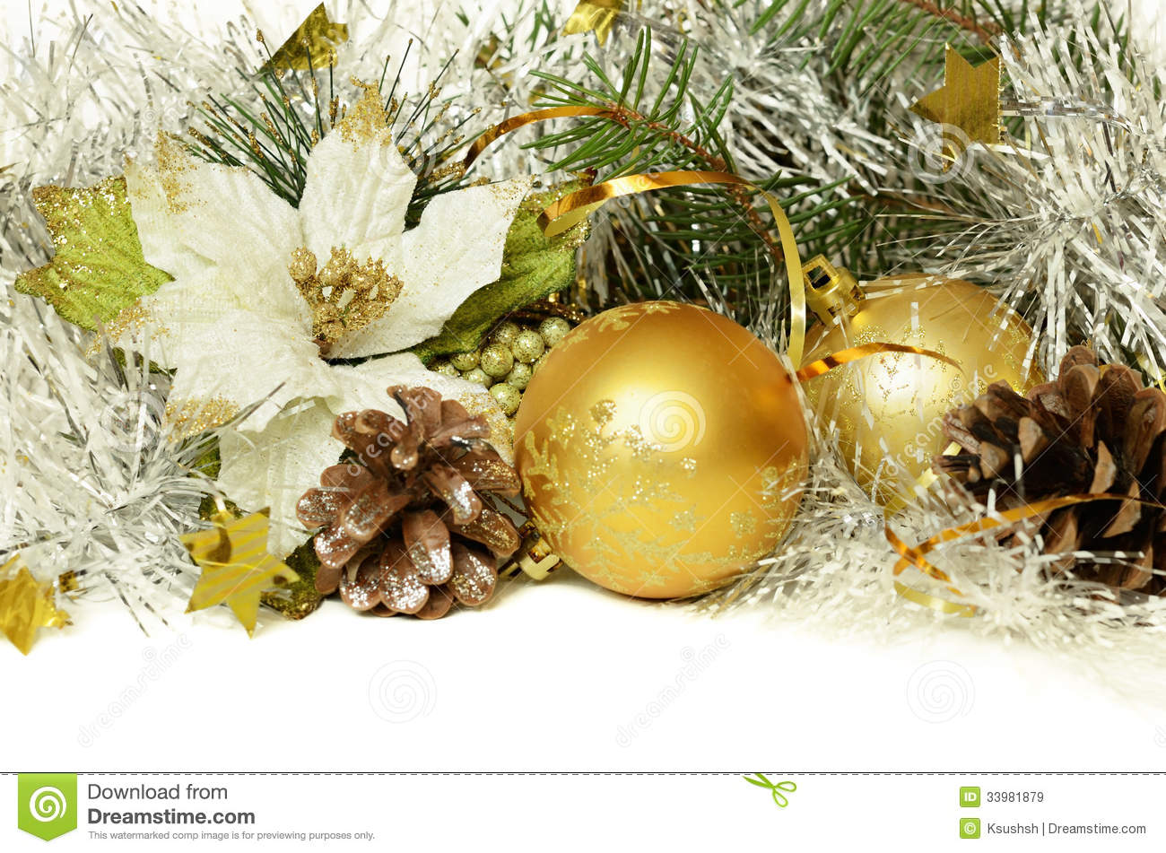 Christmas balls with tinsel, cones and artificial poinsettia