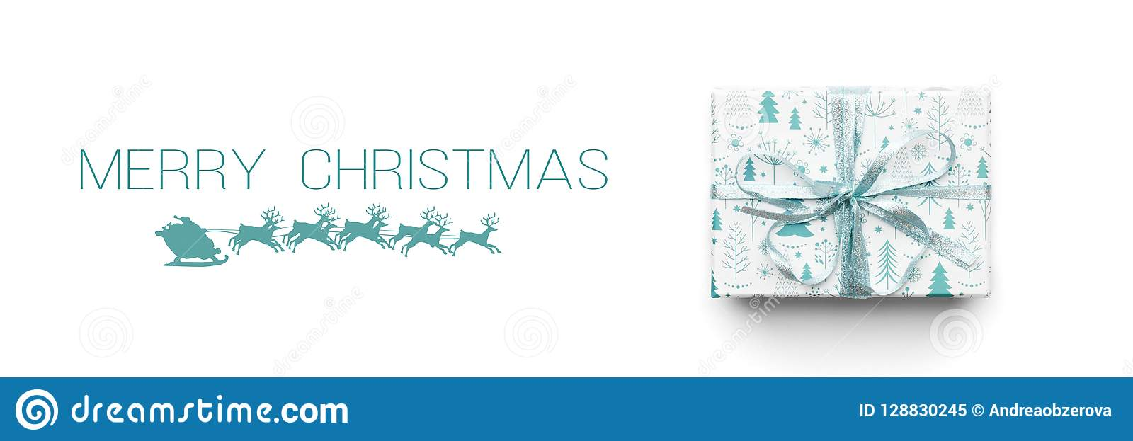 Christmas banner. Beautiful christmas gift isolated on white background. Turquoise colored wrapped xmas box.