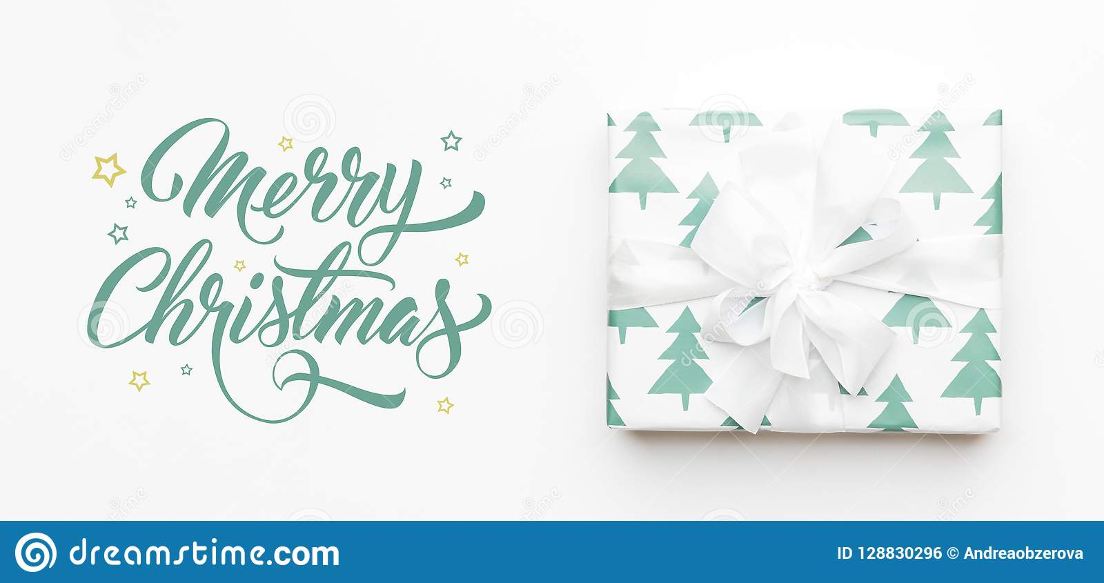 Christmas banner. Beautiful christmas gift isolated on white background. Turquoise colored wrapped xmas box. Gift wrapping.