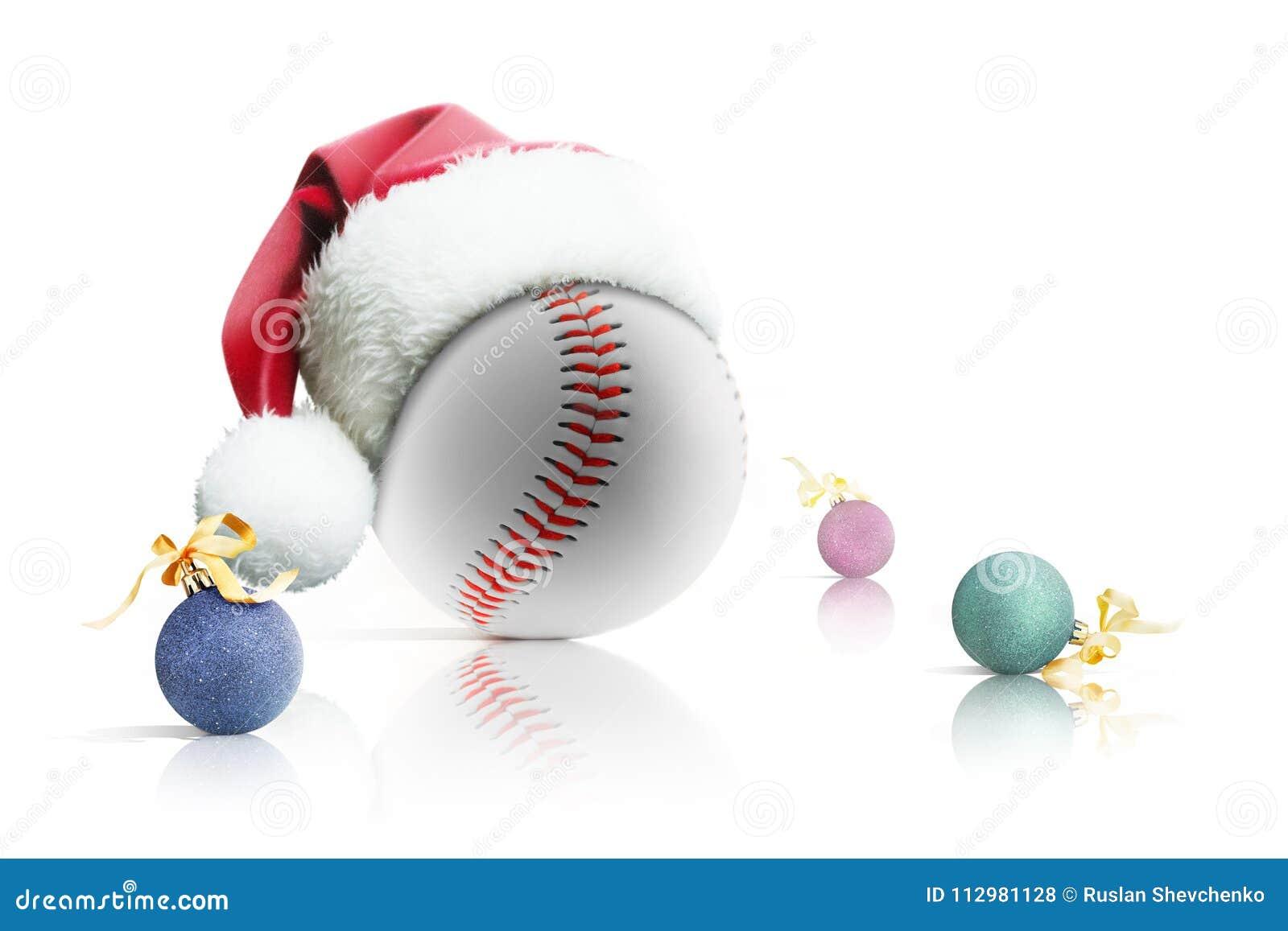 Christmas baseball. Baseball ball in Santa hat Christmas toys on white background. Isolated