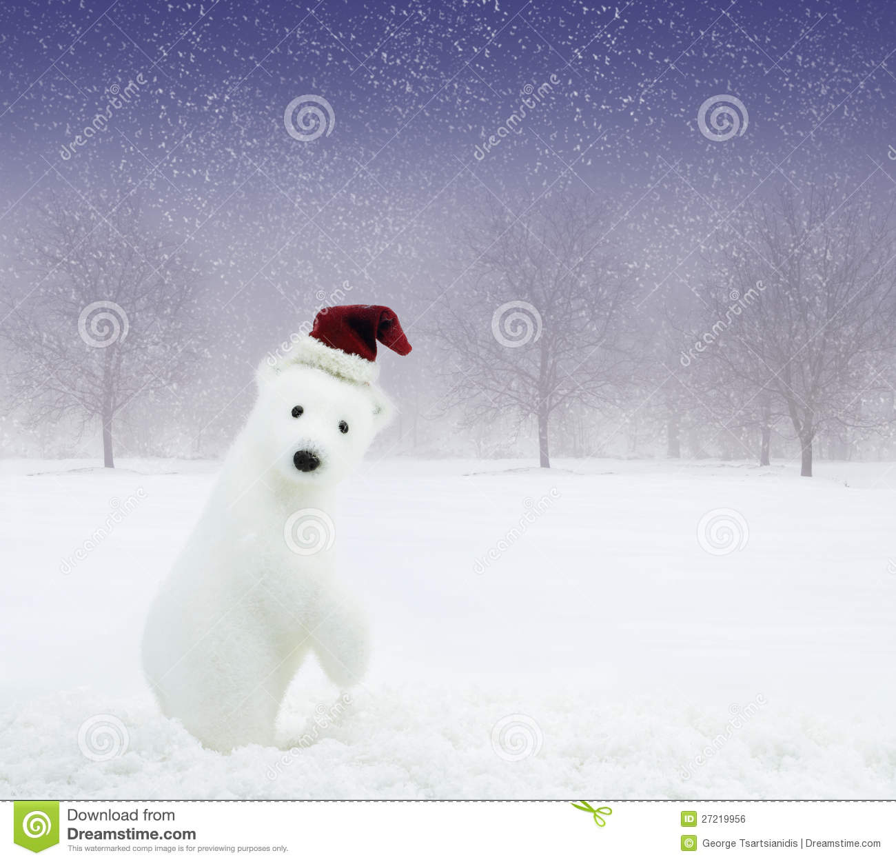 Christmas bear in snowy field