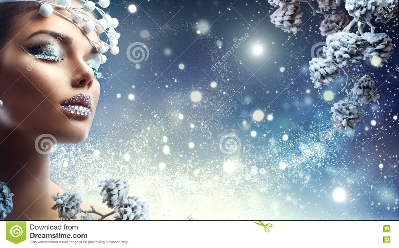 Christmas beauty girl. Winter makeup with gems on lips