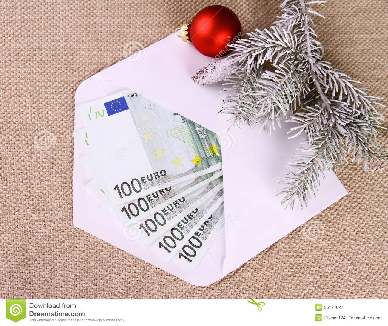 christmas bonus as five hundred euro money in envelope