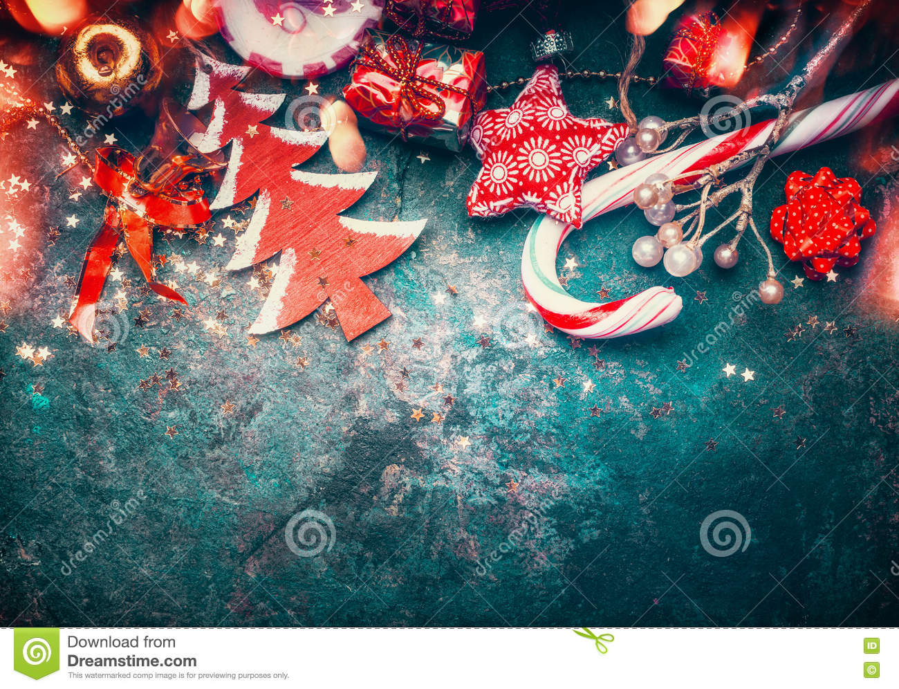 Christmas border with red decoration, christmas tree and candy on dark blue vintage background