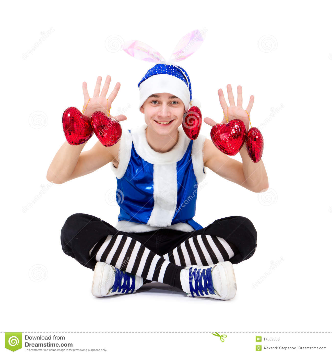 Christmas boy in blue santa hat with hearts royalty free