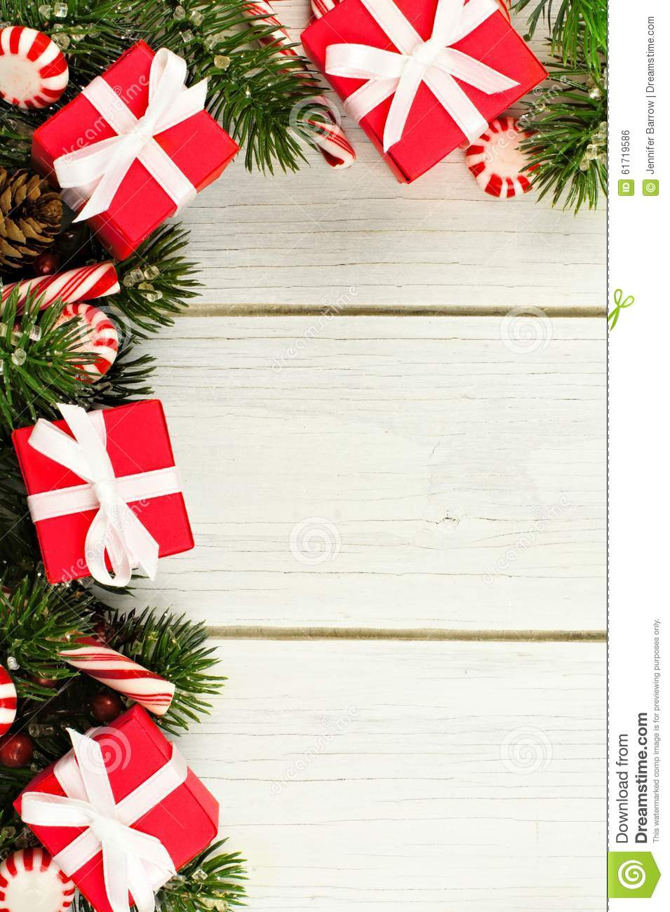 Christmas Toys Border : Christmas branches gifts and candy canes border on white