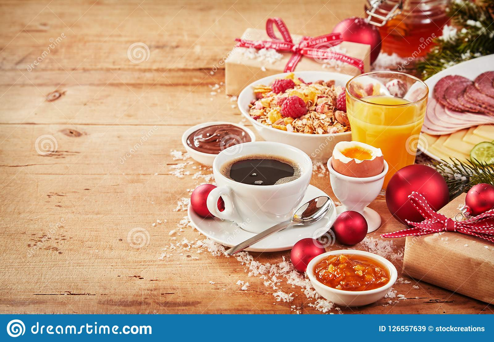 Fresh wholesome healthy Christmas intercontinental breakfast with gifts and decorations arranged to the side on a rustic wood table with copy space  sc 1 st  Dreamstime.com & Christmas Breakfast With Gifts And Decorations Stock Image - Image ...