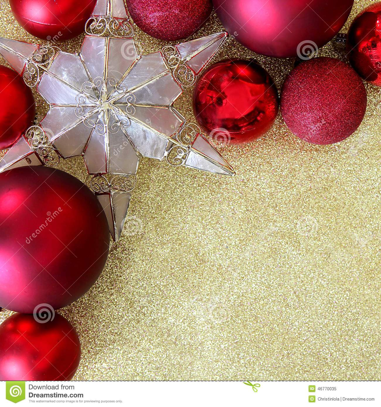 red christmas bulb decorations and a star shaped tree ornament border the corner of a background gold glitter fabric with copy space - Christmas Bulb Decorations