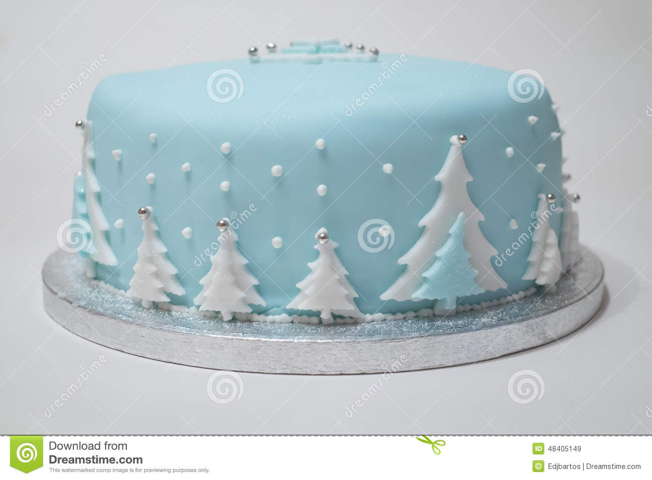 Christmas cake with blue icing christmas tree s decorate the outside