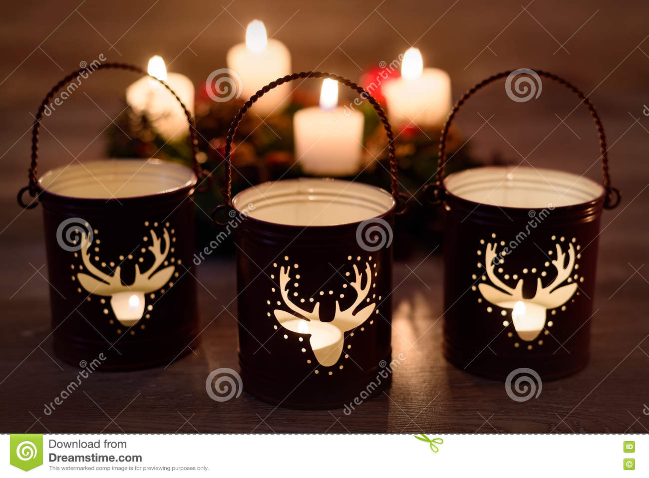 christmas candle holders on wooden background
