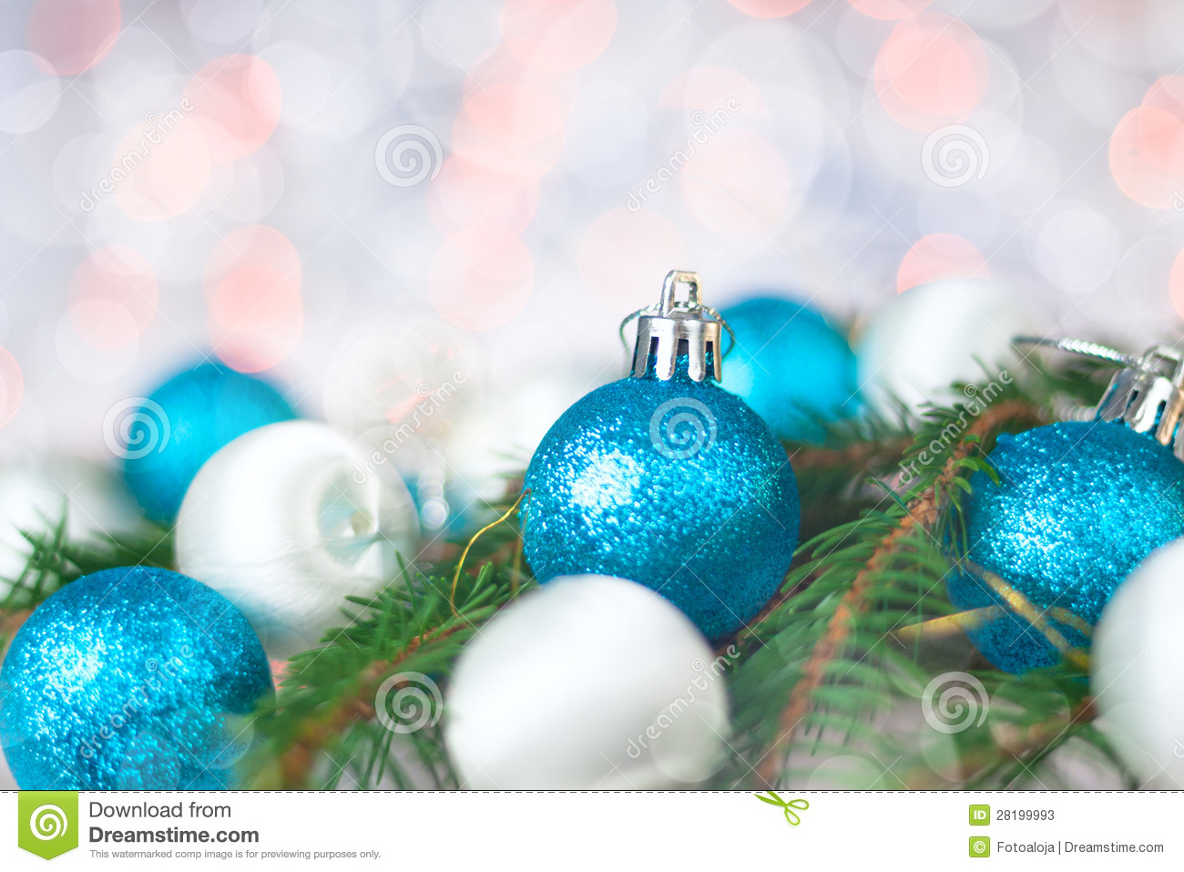 Christmas card with balls, spruce twig and bokeh