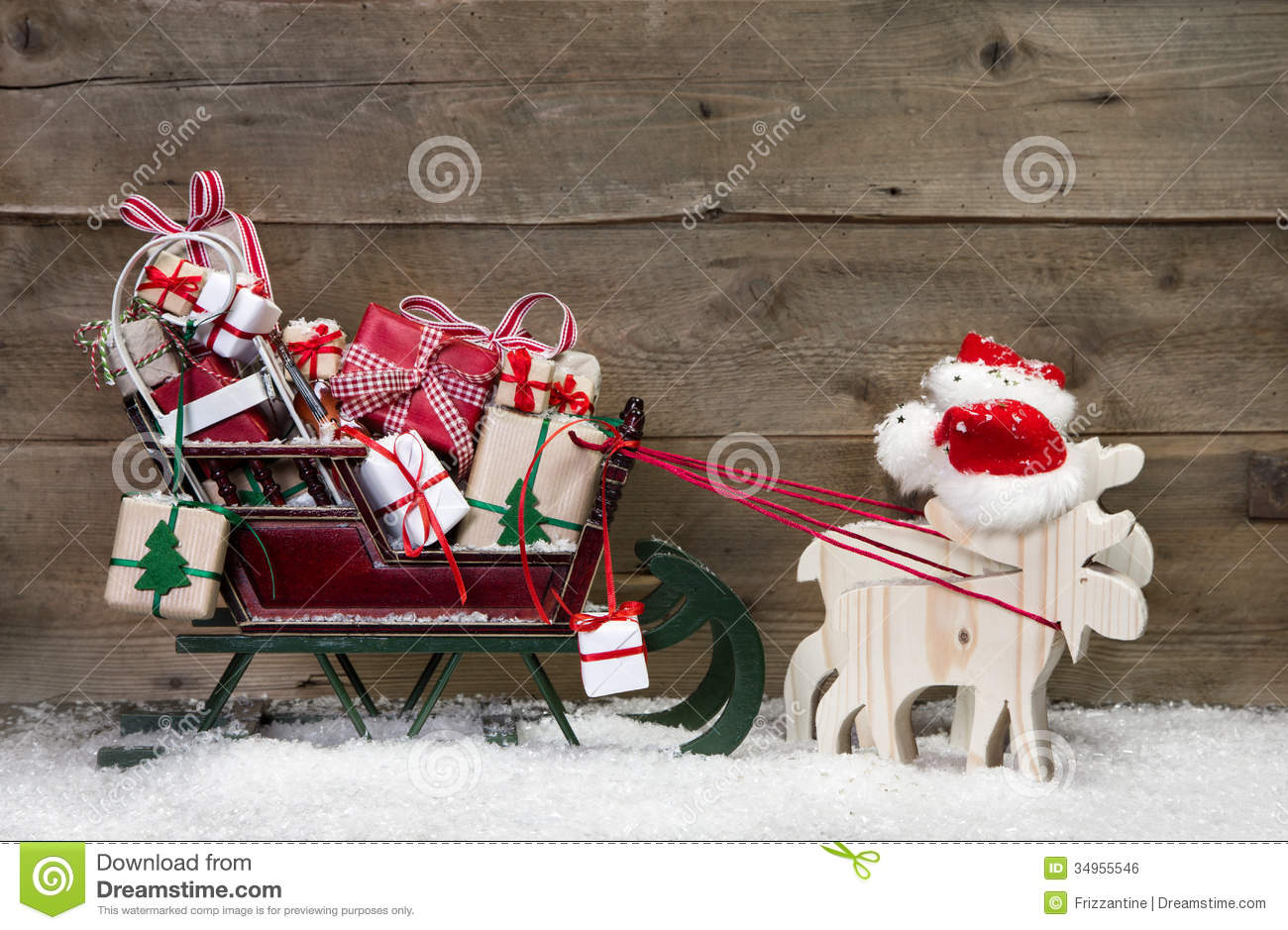 christmas card decoration elks pulling santa sleigh with gifts royalty free stock image