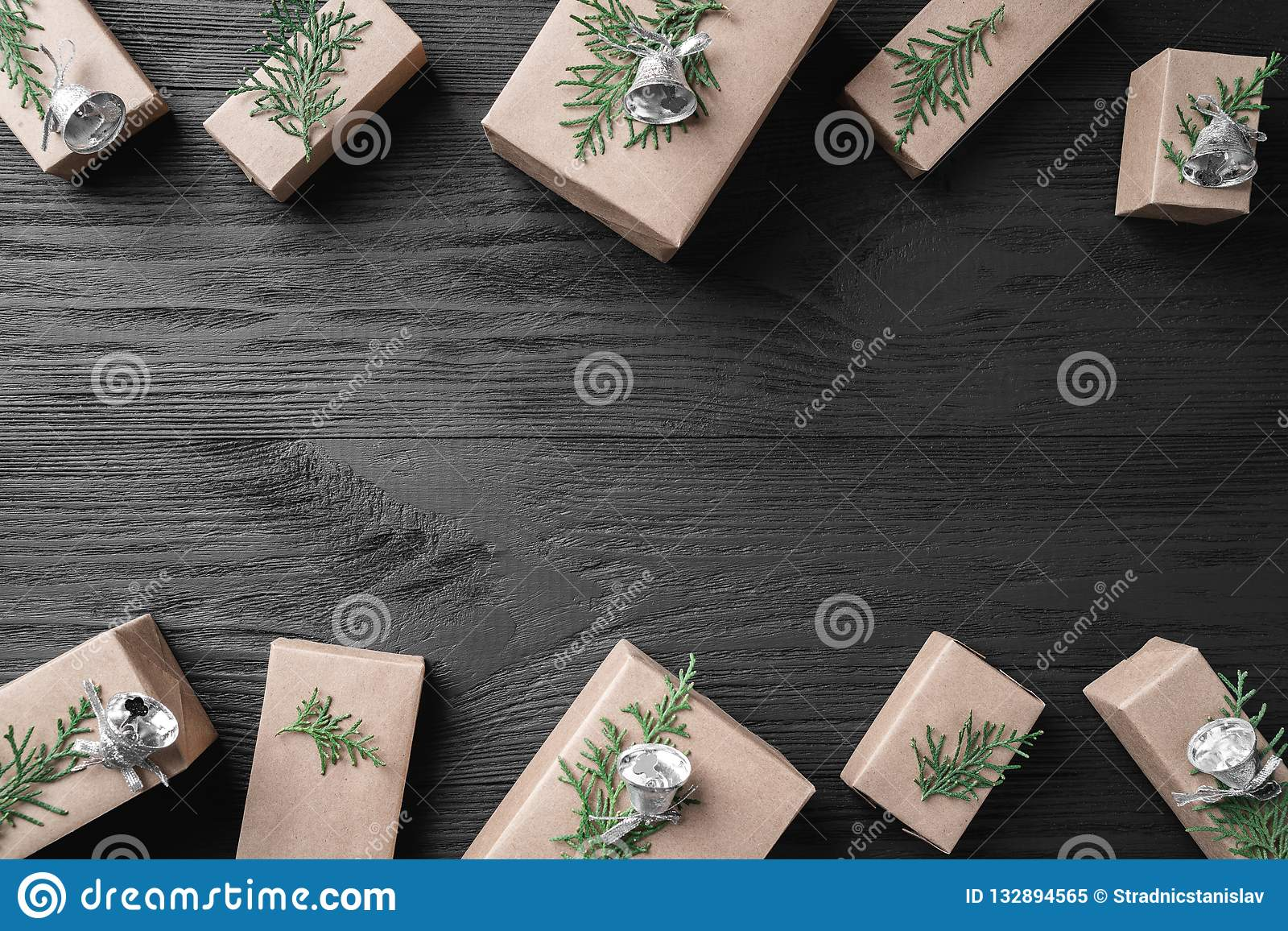 christmas card with gifts on a dark wooden rustic