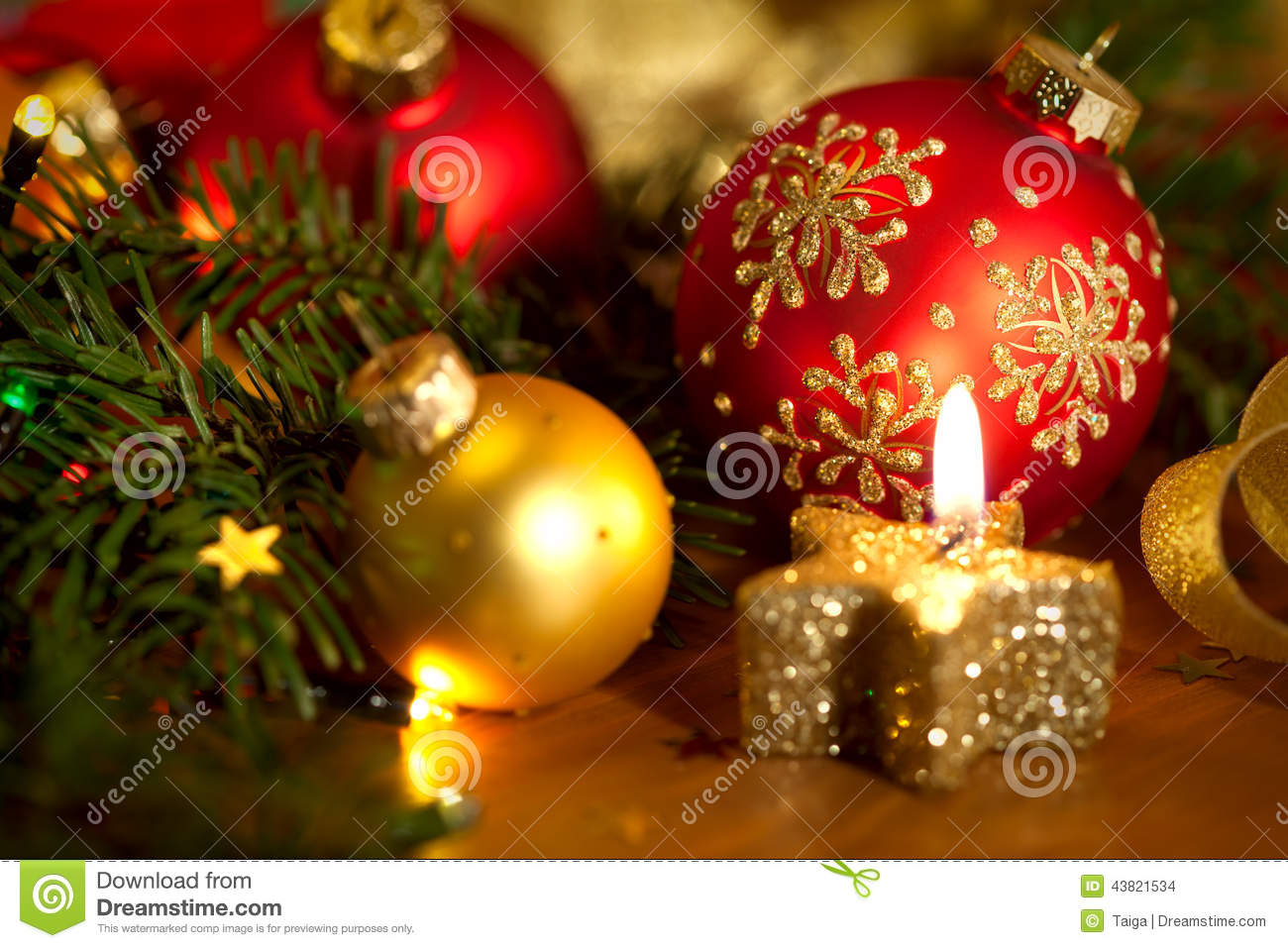 Christmas card with golden candle, balls, pine tree, lights and