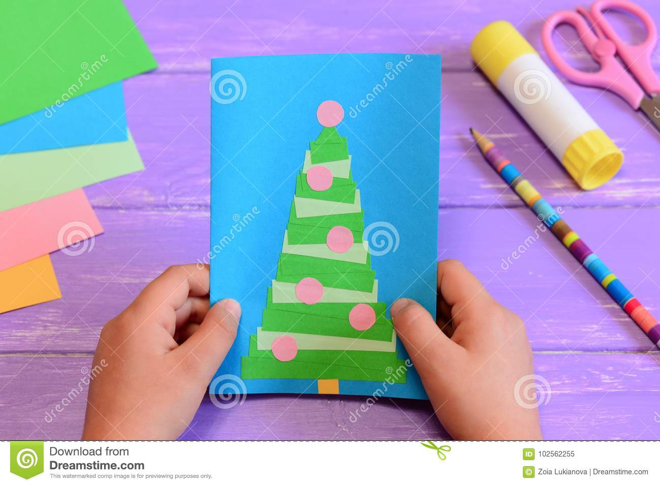 Child Holds A Christmas Greeting Card In His Hands. Child Made A ...
