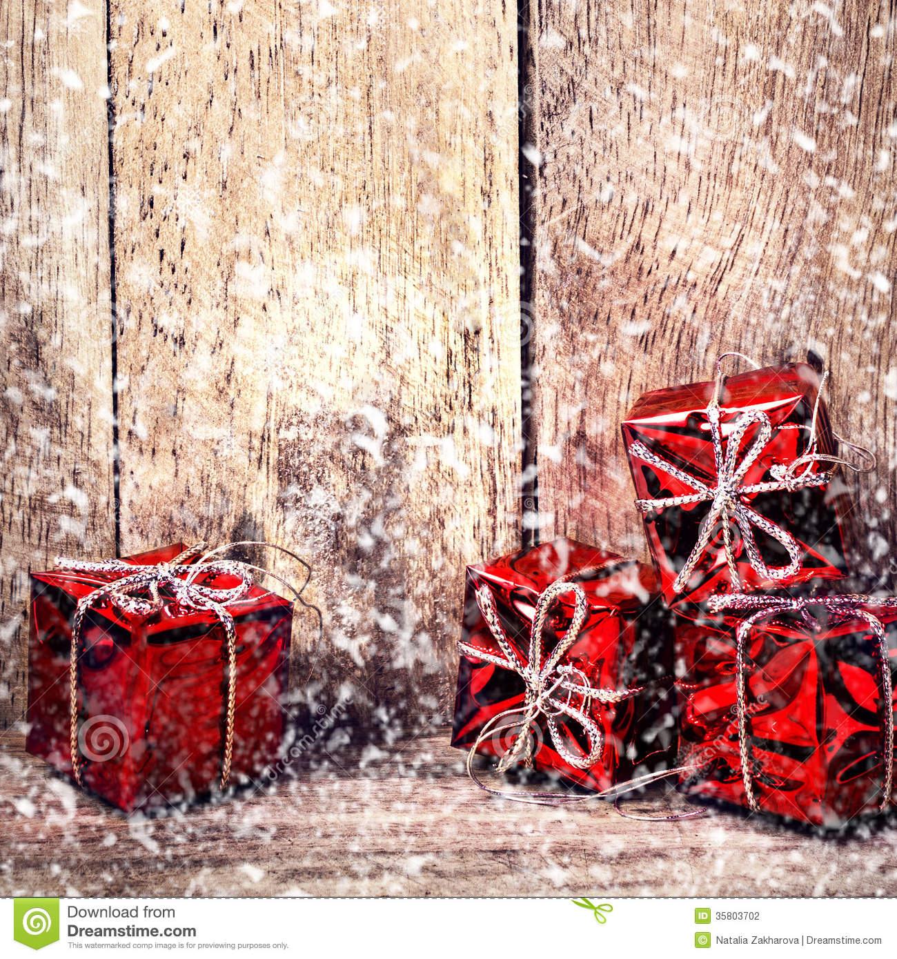 Christmas Card With Red Gift Boxes And Falling Snow On Rustic Wo ...