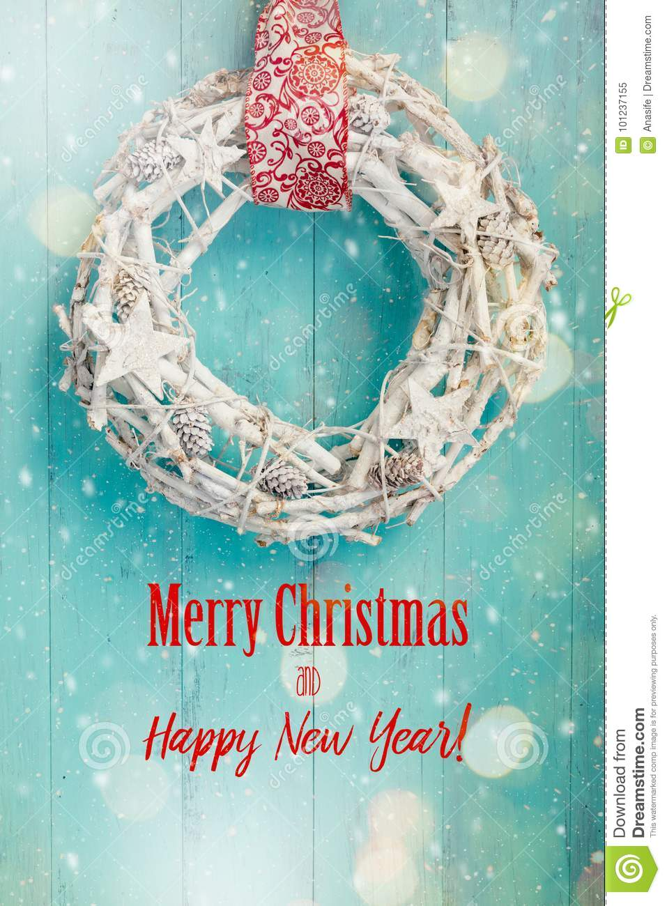 christmas card with white wreath on a turquoise door stock image