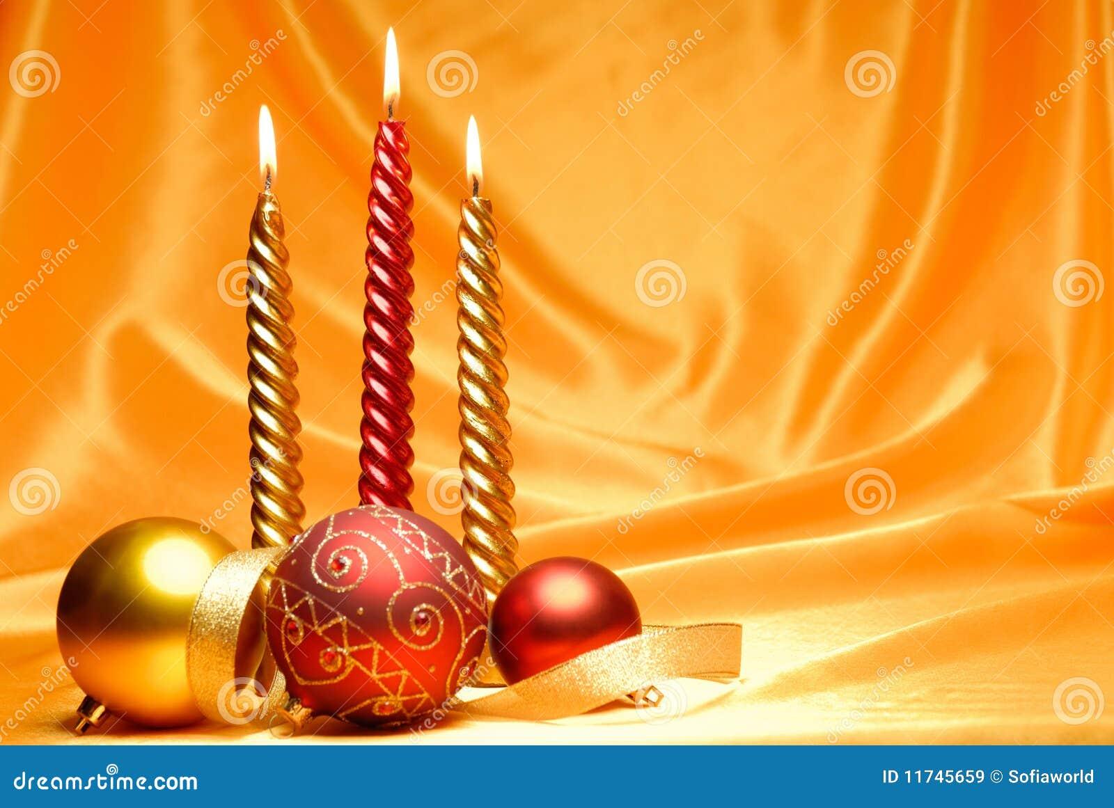 Christmas celebration,burning candles and christmas balls with silky ...