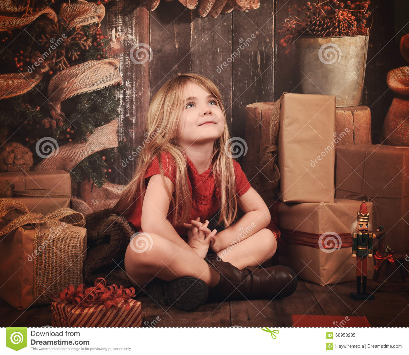 Christmas Child Making Wish in Wooden Room