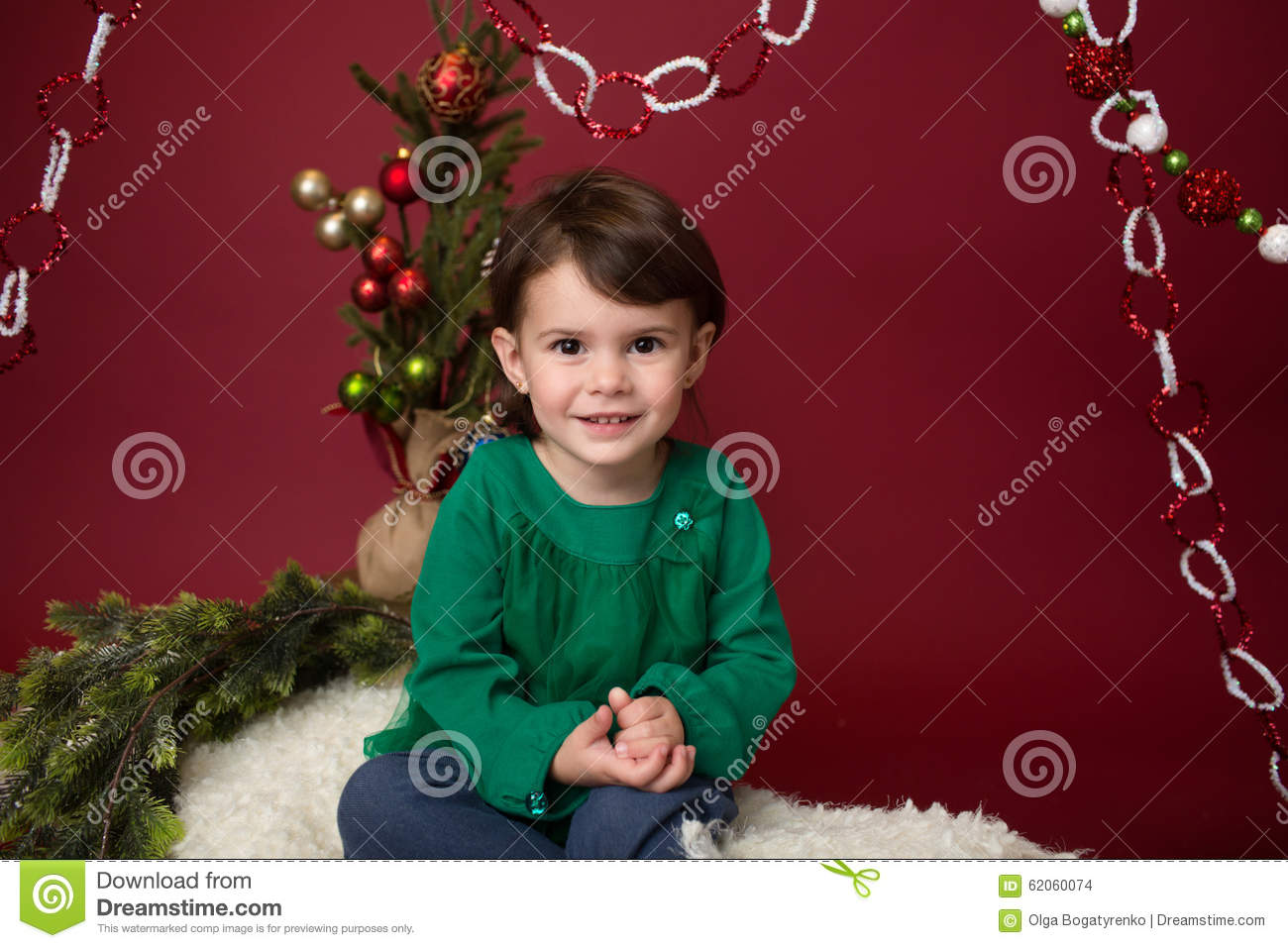 c3a07474b Christmas Child On Sled Against Christmas Tree With Ornaments Stock ...