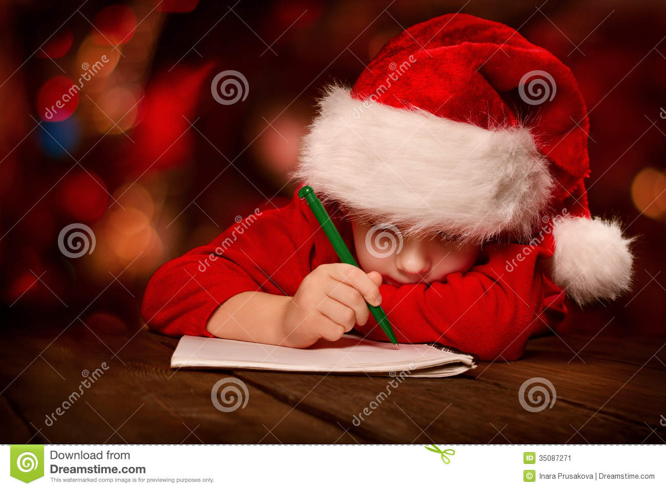 Christmas Child Writing Letter In Red Santa Hat Stock Image  Image