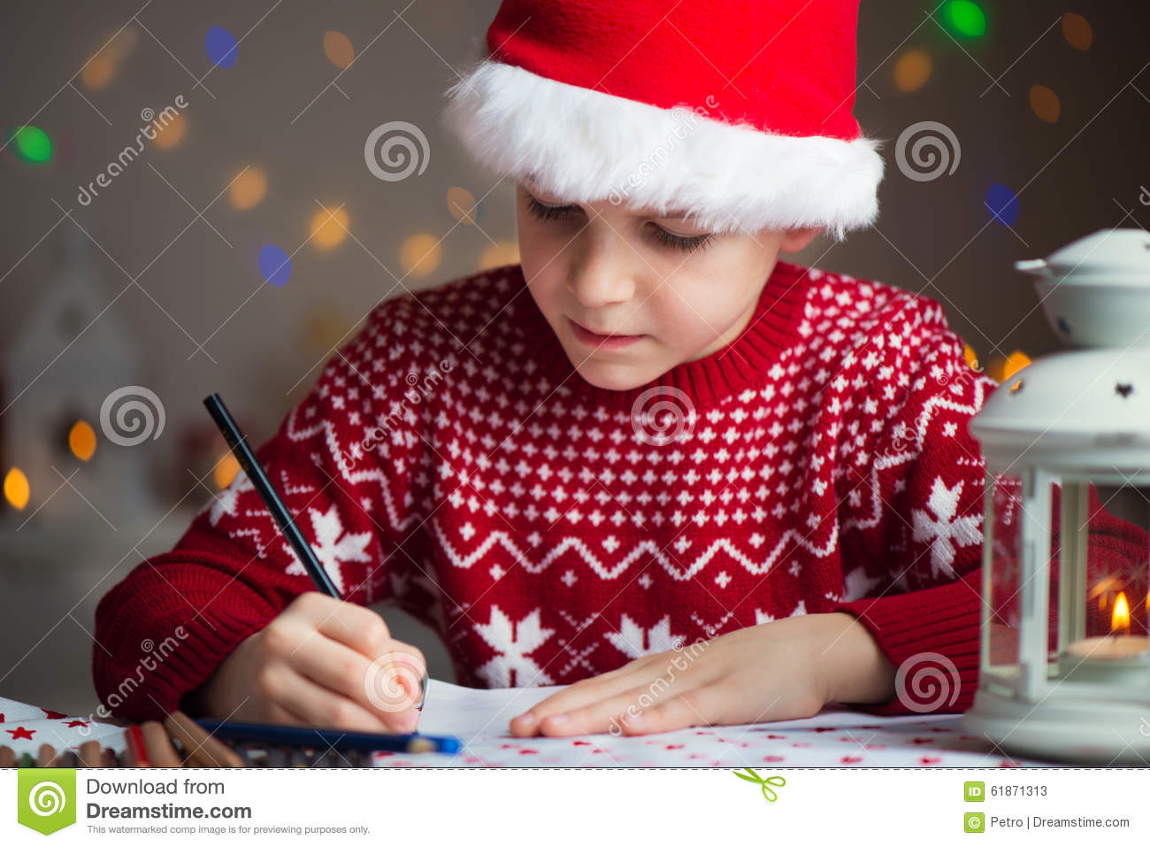christmas child writing letter to santa claus letter in red hat