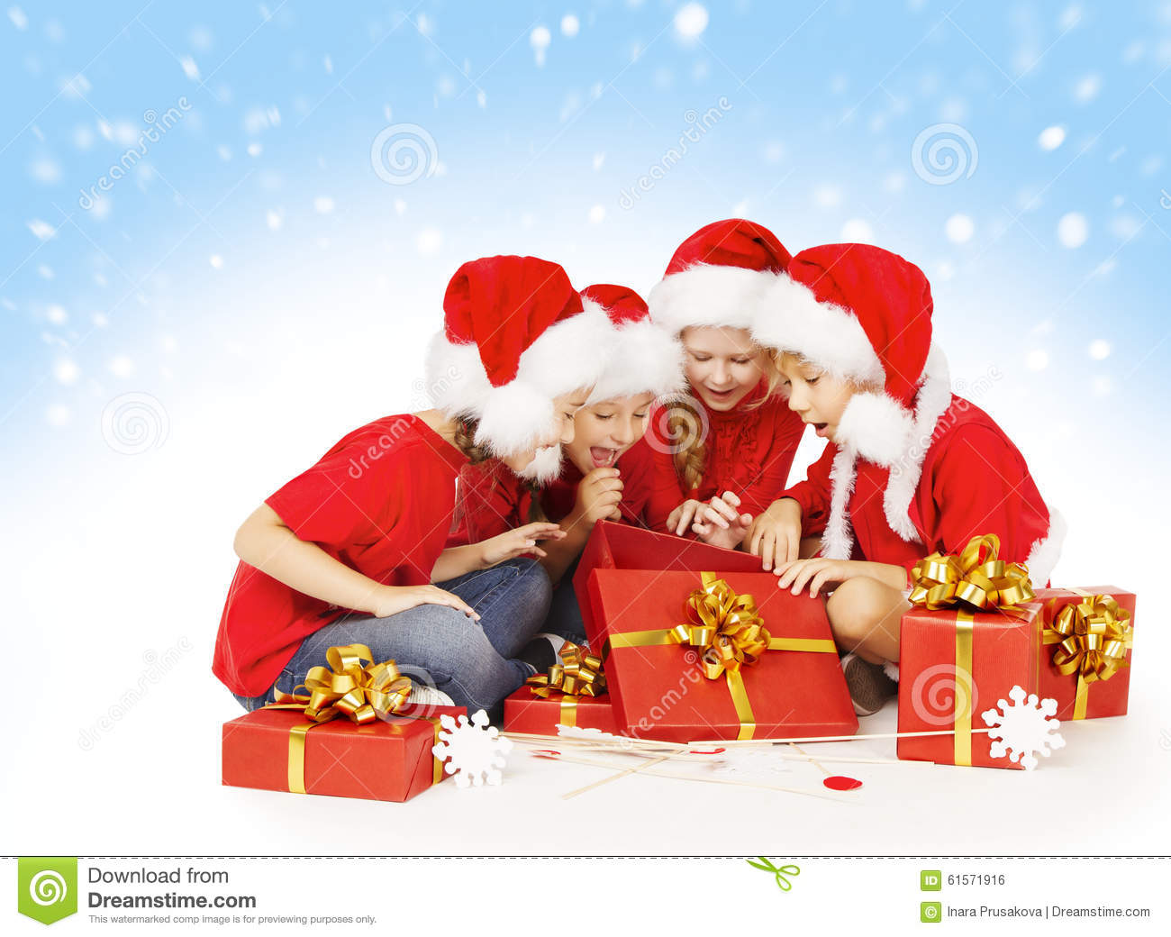 Christmas Children Open Presents, Kids Group In Santa Hat Stock ...
