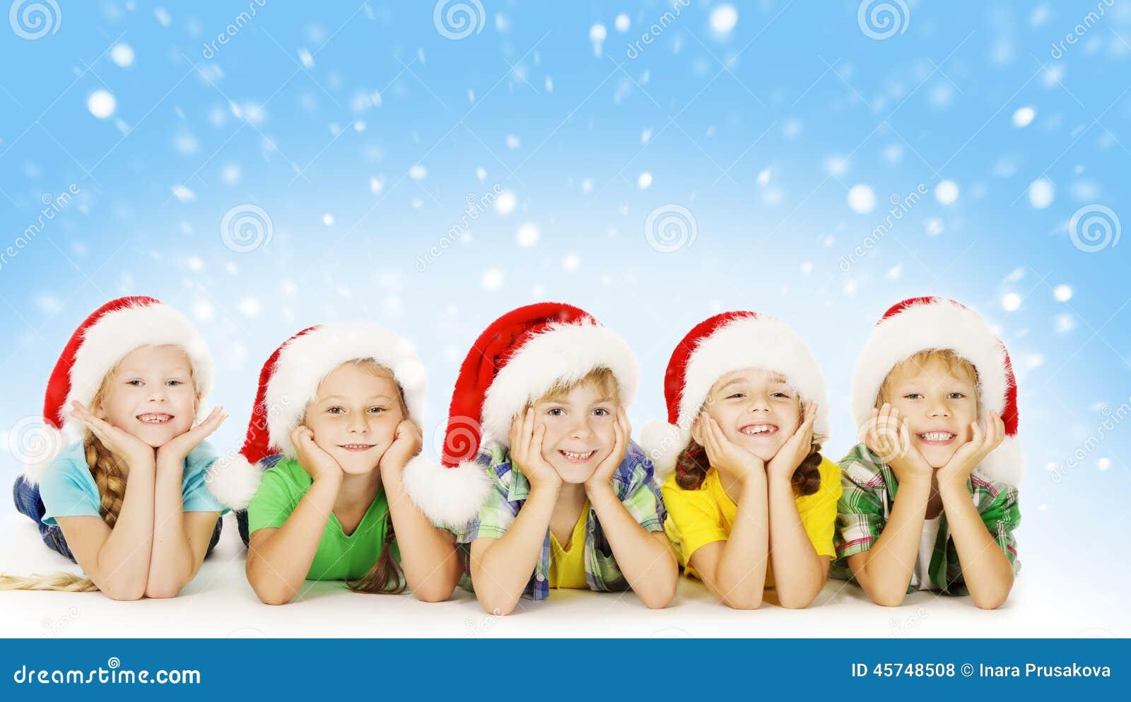 Christmas Children In Santa Helper Hat, Little Xmas Kids Stock Photo ...