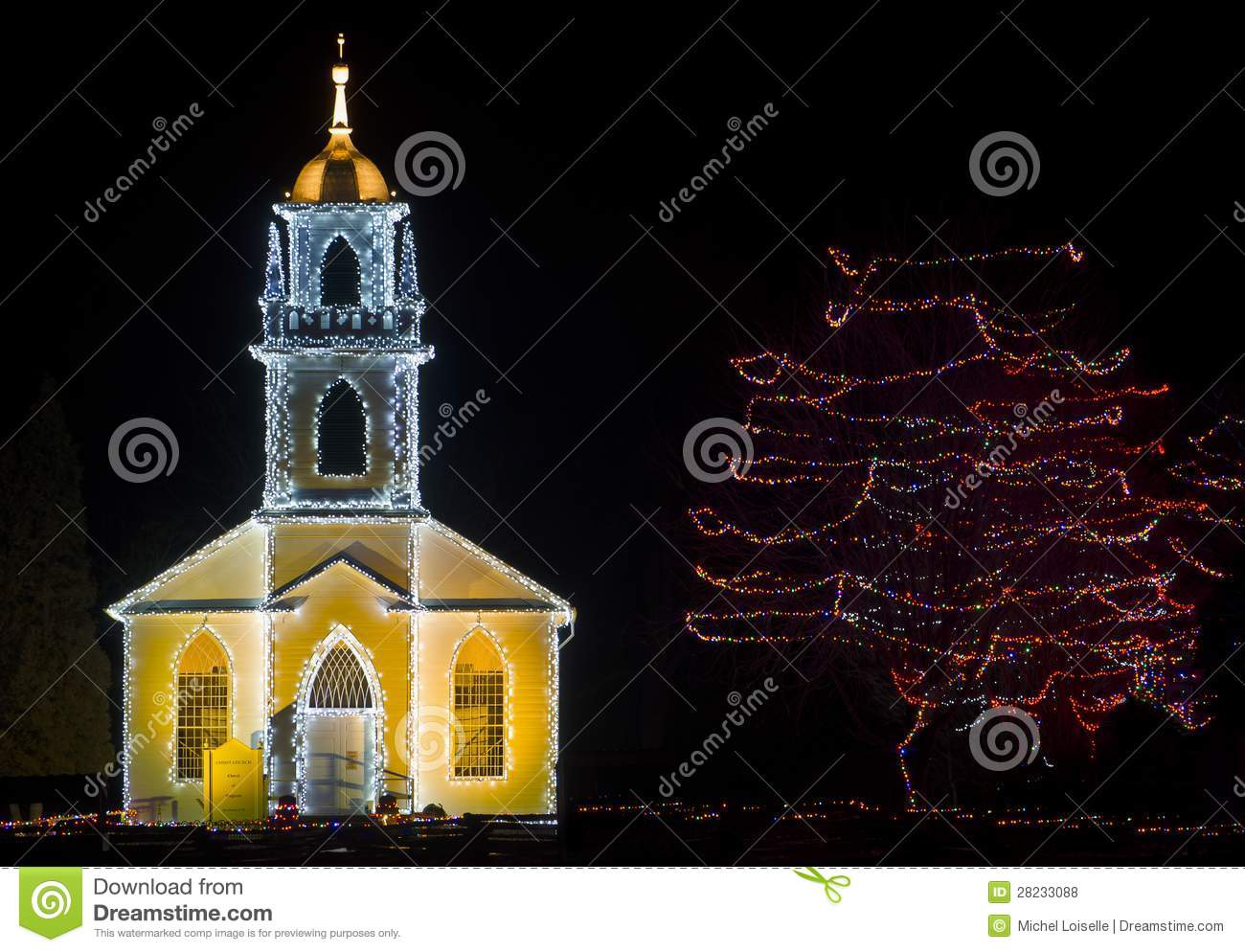 Beautiful village church with bell tower decorated for christmas