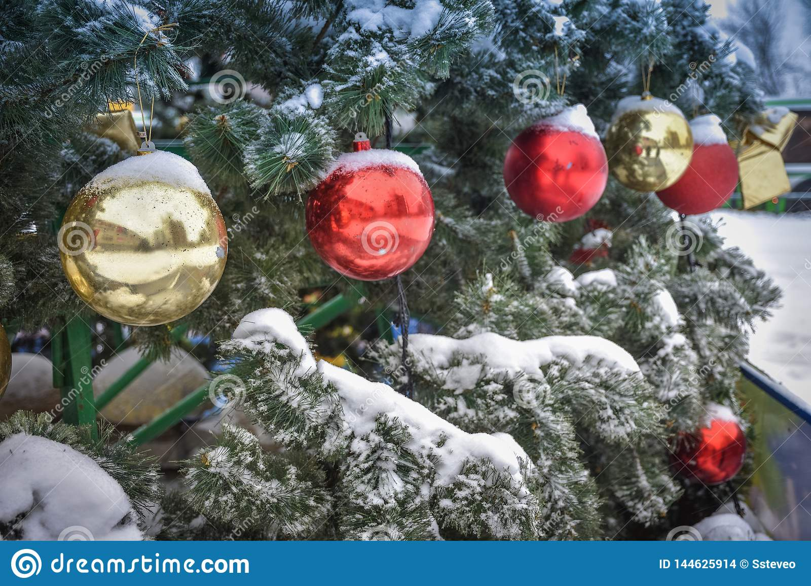 Christmas colored balls on the tree in the snow