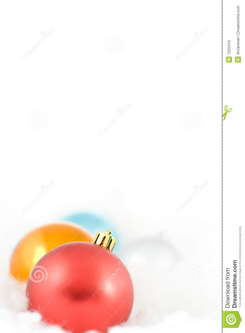 Christmas colored balls in white clouds stock photo