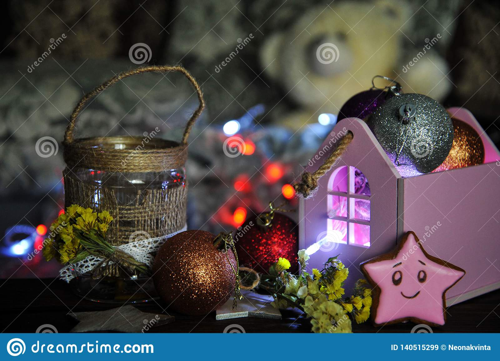 Christmas composition with a candle and Christmas decorations on a table