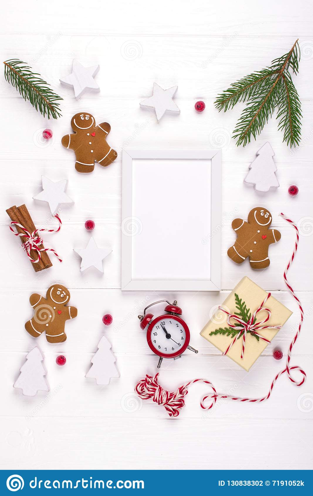 Christmas composition. Christmas gifts, decor, fir tree branches gingerbread man cookies . Winter holidays concept.