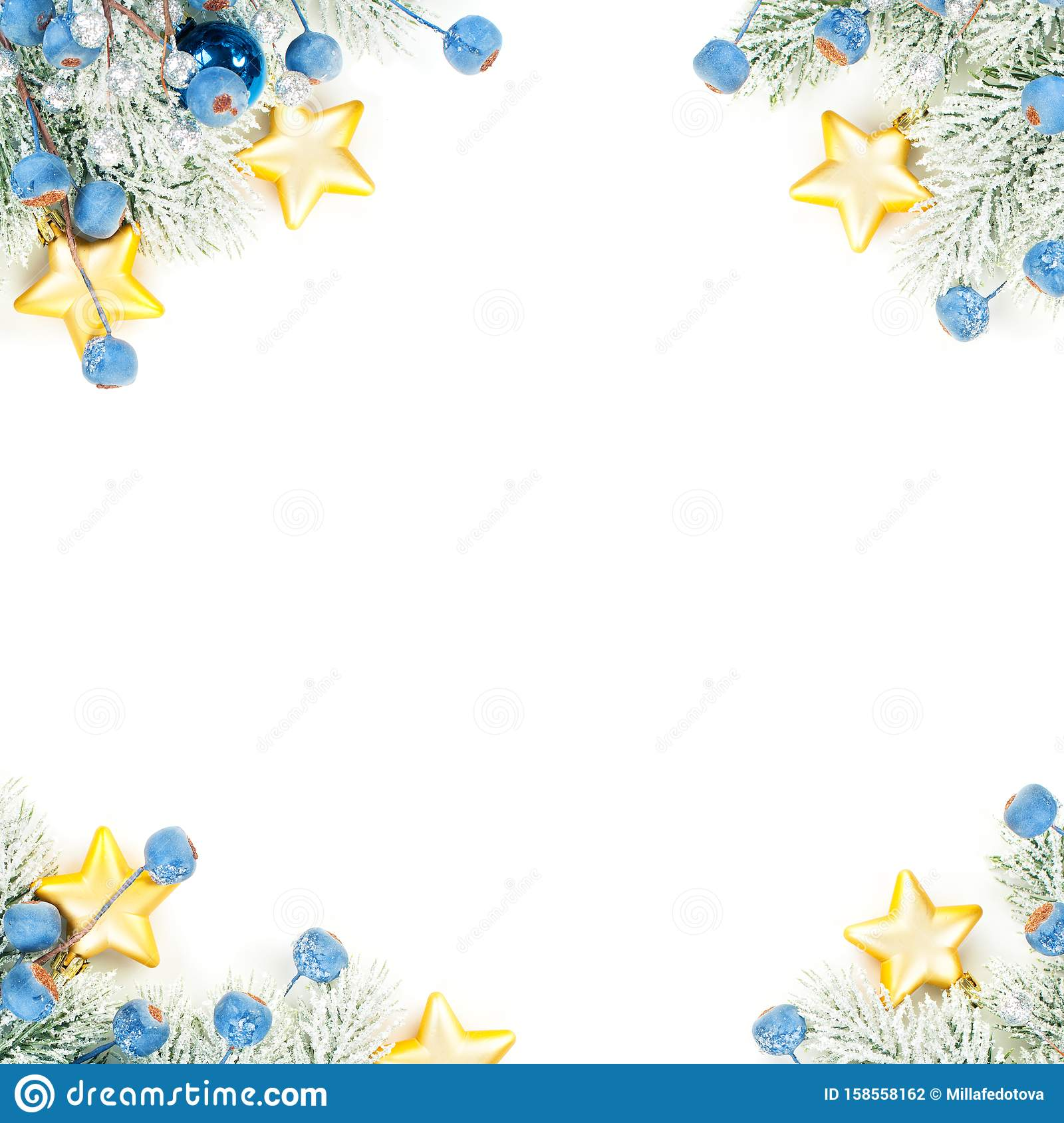 Christmas composition corner top view. Colorful winter background with green Xmas tree twig, blue decoration and gold stars