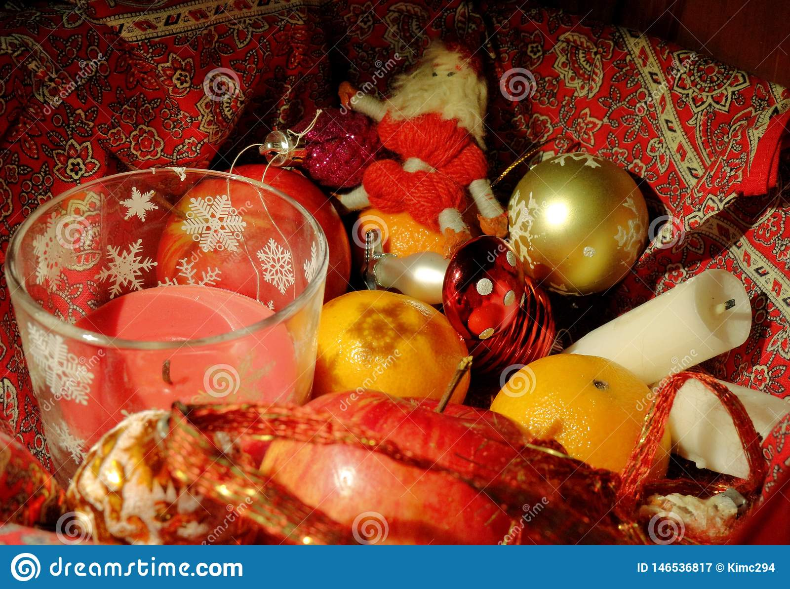 Christmas composition with fruit, candles and Christmas decor