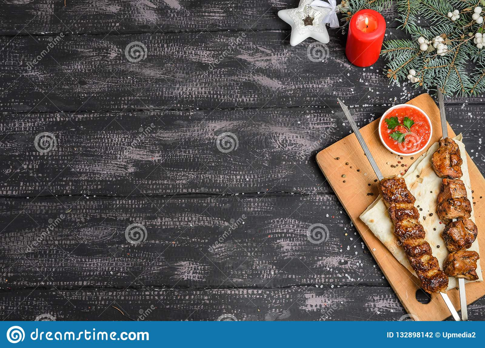 Christmas composition with kebab on wooden table