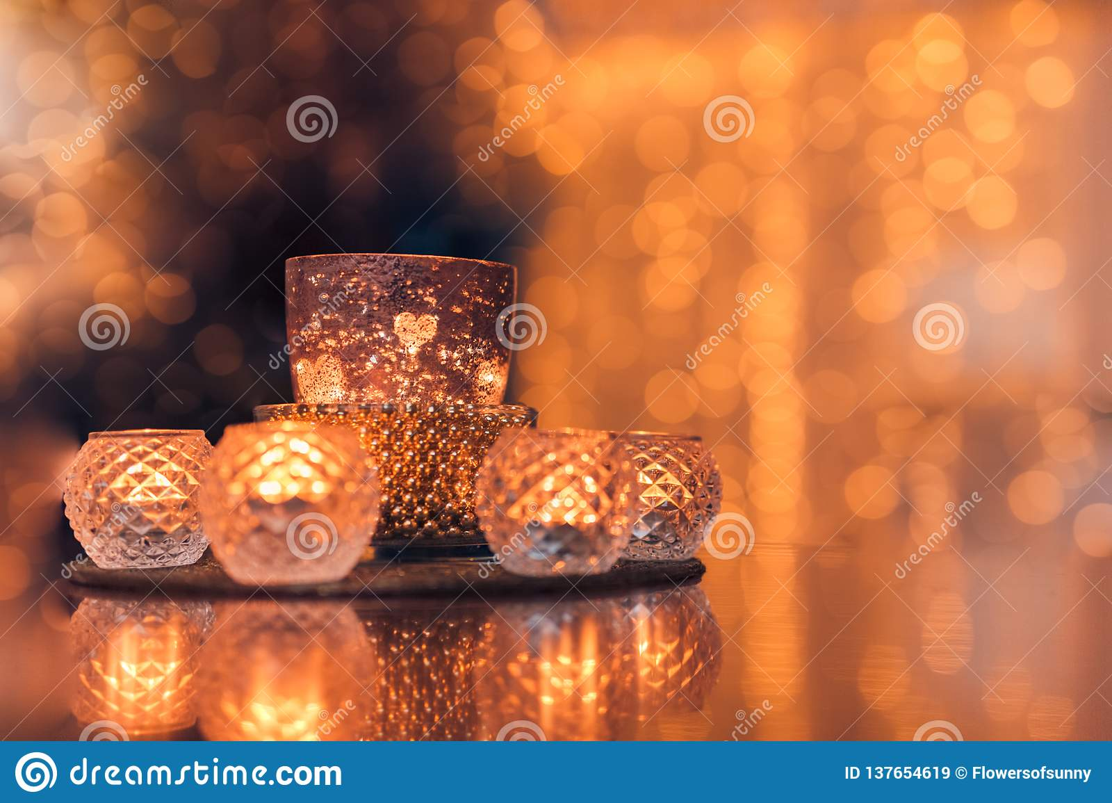 Christmas composition warm candles, dried oranges on table. Holiday, New Year, Christmas, cosiness concept. Cozy home