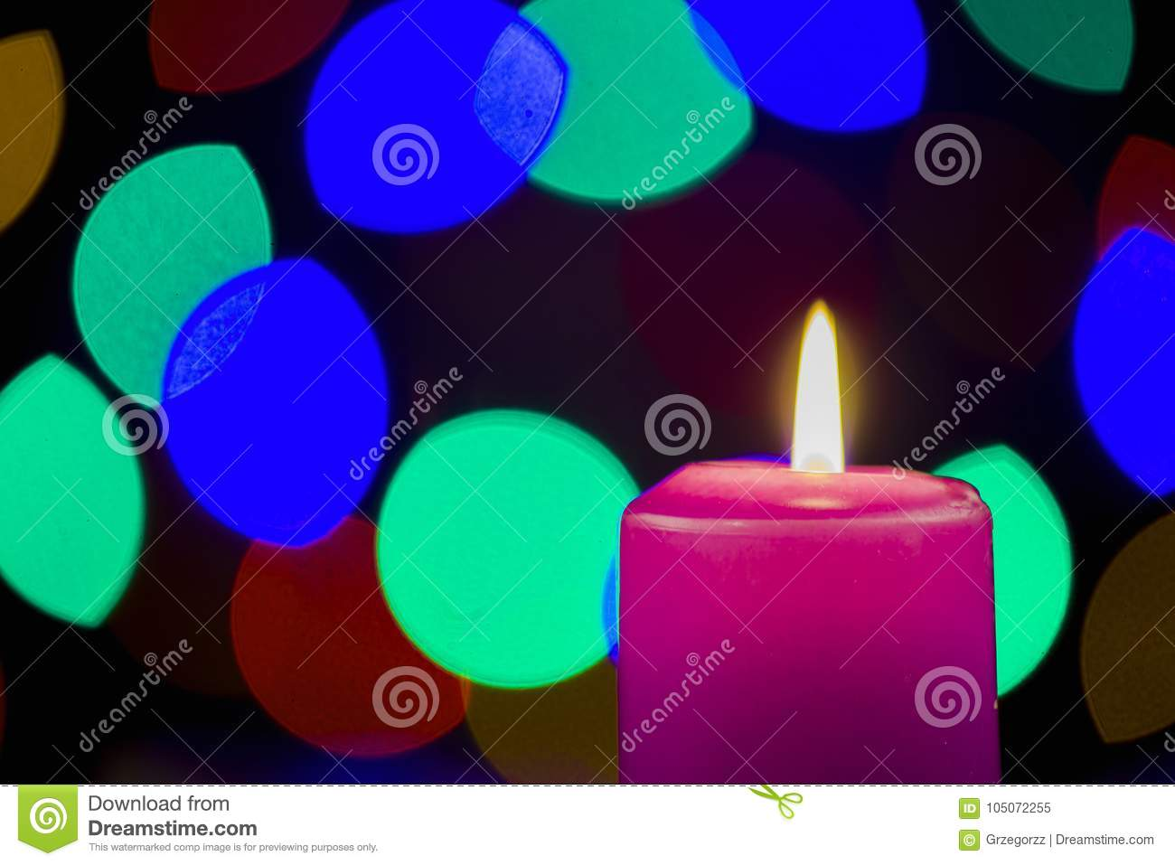 Fuzzy Black Background : Candles on the christmas table stock image of