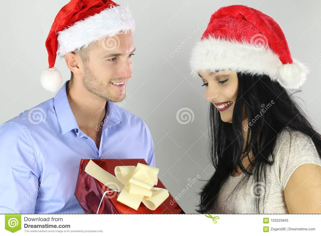 Christmas Concept. Boyfriend Offering A Christmas Gift To His ...