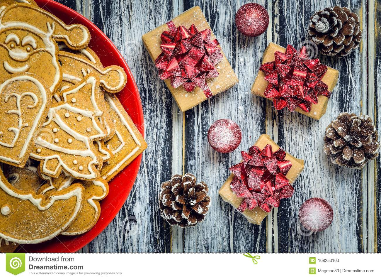 Christmas concept with gingerbread, gifts and snow.
