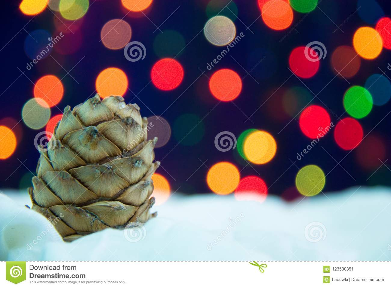 Christmas cone with snow and vivid abstract background bright