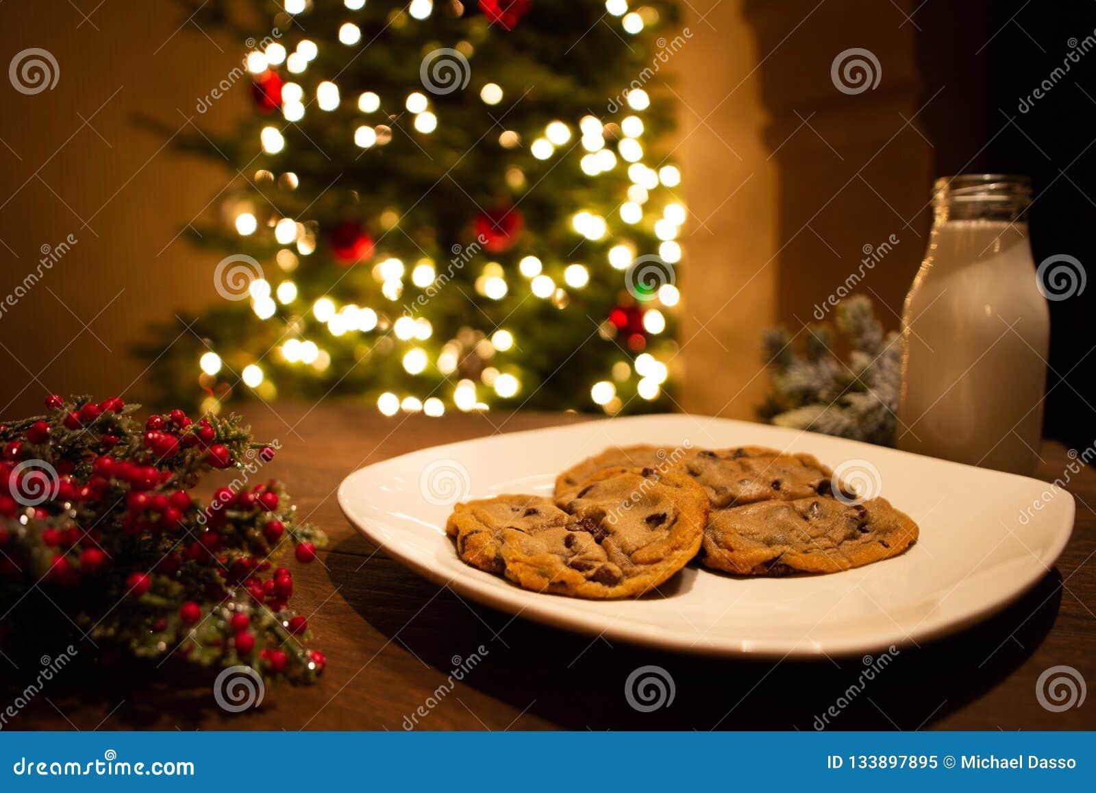 Christmas Cookies And Milk Waiting For Santa With Christmas Tree