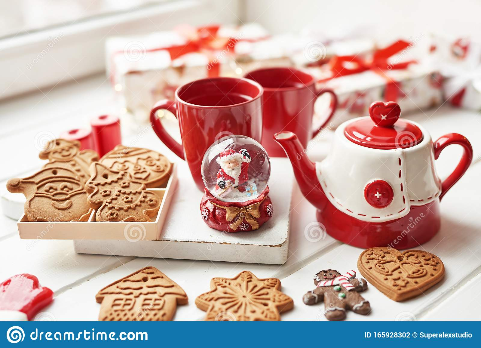 Christmas Cookies And Mug Of Hot Tea Christmas Time Christmas Gingerbread Candy Coffee In Red Cup On Wooden Table On Frosty Stock Photo Image Of Background Cake 165928302