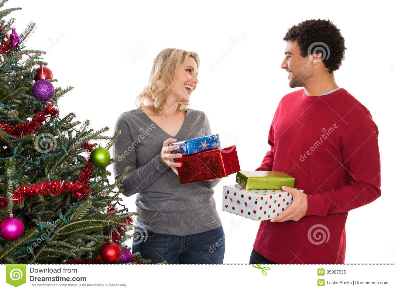 Christmas Couple Giving Gifts Royalty Free Stock Photo ...