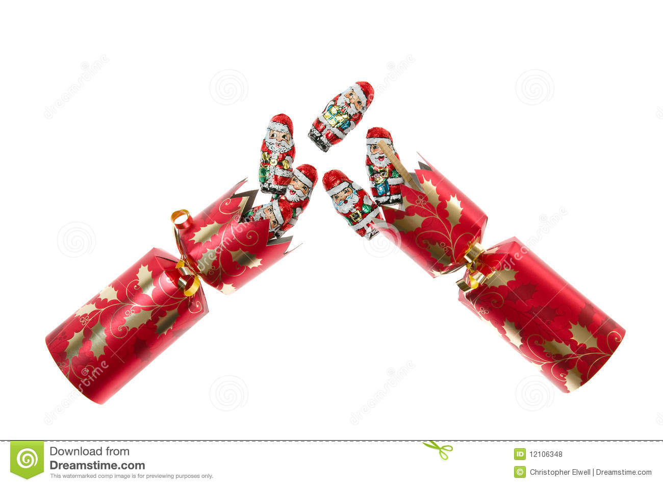 Christmas cracker pulled apart with foil covered chocolate Santas ...